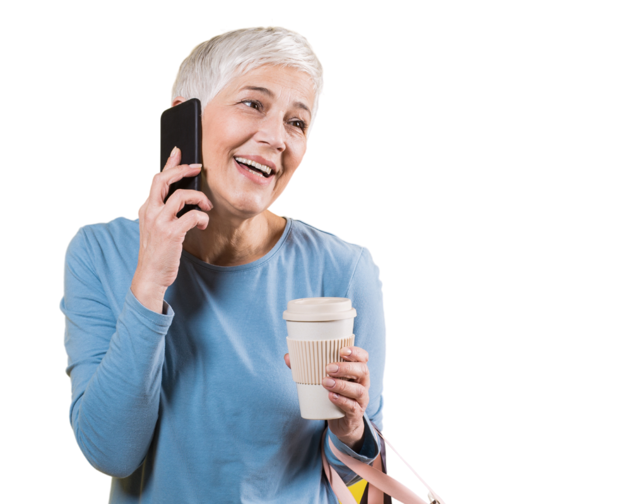 Woman on the phone carrying a coffee